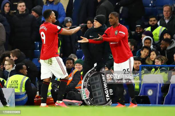 Odion Ighalo of Manchester United replaces teammate Anthony Martial as a substitute during the Premier League match between Chelsea FC and Manchester...
