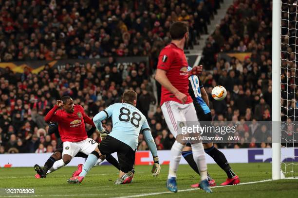 Odion Ighalo of Manchester United scores a goal to make it 2-0 during the UEFA Europa League round of 32 second leg match between Manchester United...