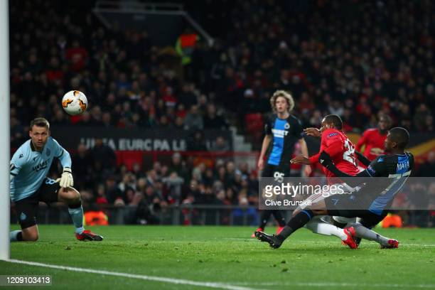 Odion Ighalo of Manchester United scores his team's second goal past Simon Mignolet of Club Brugge during the UEFA Europa League round of 32 second...