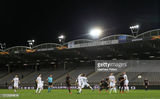 Odion Ighalo of Manchester United scores their first goal during the UEFA Europa League round of 16 first leg match between LASK and Manchester...