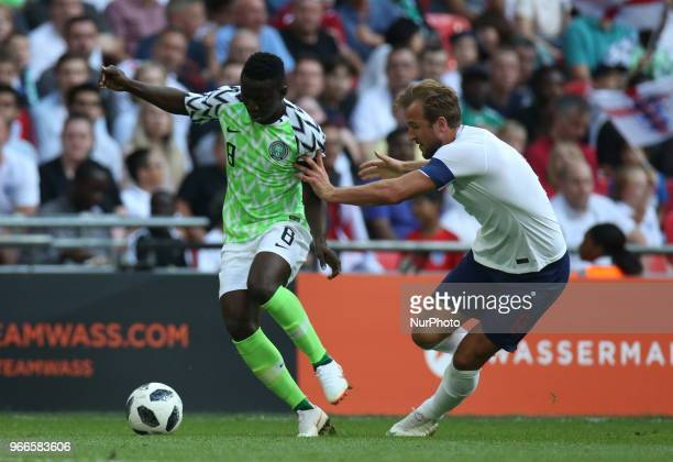 LR Odion Ighalo of Nigeria and England's Harry Kane during International match between England against Nigeria at Wembley stadium London on 02 June...
