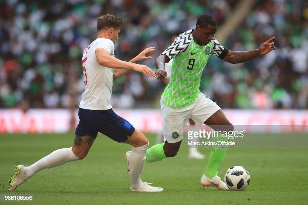 Odion Ighalo of Nigeria in action with John Stones of England during an International Friendly between England and Nigeria at Wembley Stadium on June...