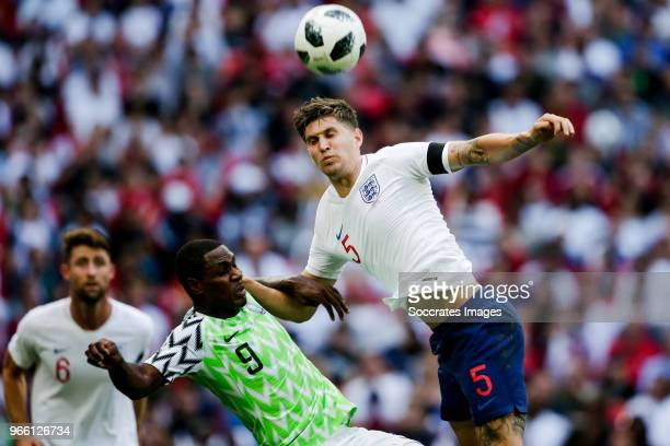 Odion Ighalo of Nigeria John Stones of England during the International Friendly match between England v Nigeria at the Wembley Stadium on June 2...