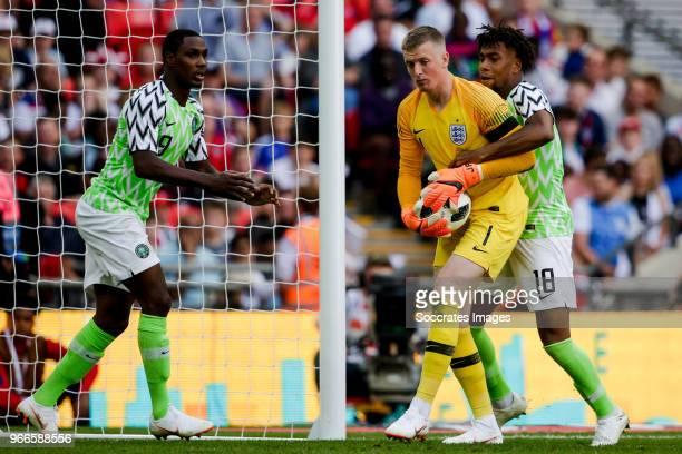 Odion Ighalo of Nigeria Jordan Pickford of England Alex Iwobi of Nigeria during the International Friendly match between England v Nigeria at the...