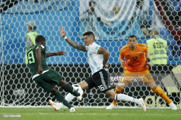 Odion Ighalo of Nigeria Marcos Rojo of Argentina goalkeeper Franco Armani of Argentina during the 2018 FIFA World Cup Russia group D match between...