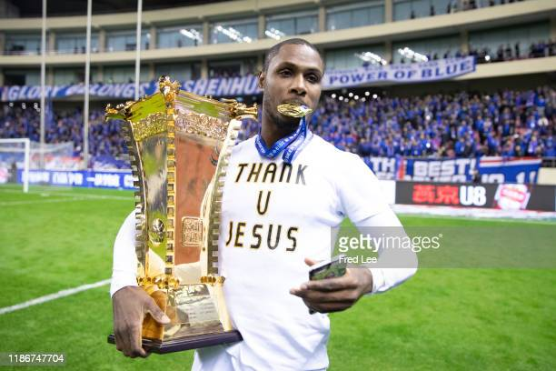 Odion Ighalo of Shanghai Greenland Shenhua and teammates celebrate with the trophy during the award ceremony after the 2019 CFA Cup Final Shanghai...