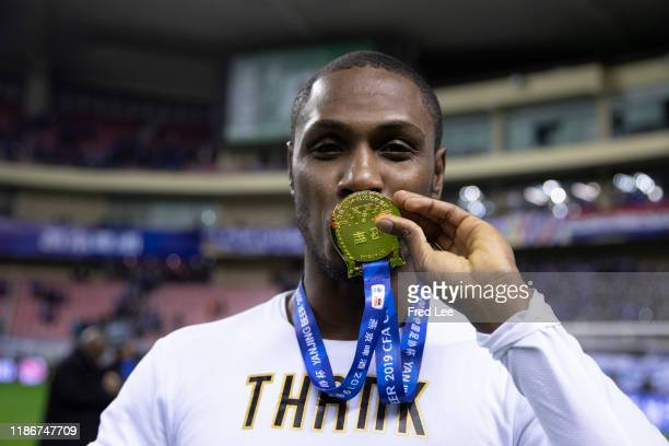 Odion Ighalo of Shanghai Greenland Shenhua and teammates celebrate with the trophy during the award ceremony after the 2019 CFA Cup Final - Shanghai...