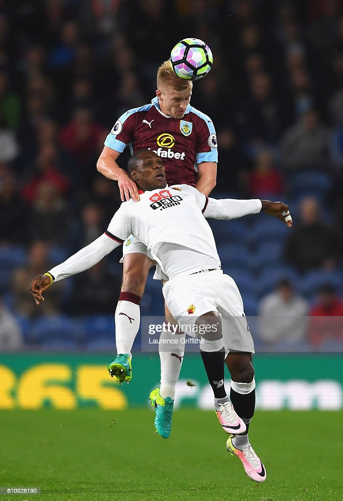 Odion Ighalo of Watford and Ben Mee of Burnley battle for possesion during the Premier League match between Burnley and Watford at Turf Moor on September 26, 2016 in Burnley, England.
