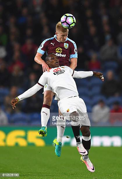 Odion Ighalo of Watford and Ben Mee of Burnley battle for possesion during the Premier League match between Burnley and Watford at Turf Moor on...