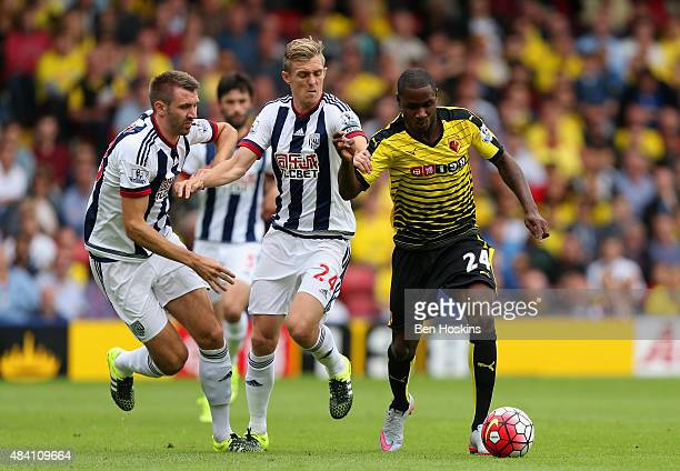 Odion Ighalo of Watford and Darren Fletcher of West Bromwich Albion compete for the ball during the Barclays Premier League match between Watford and...