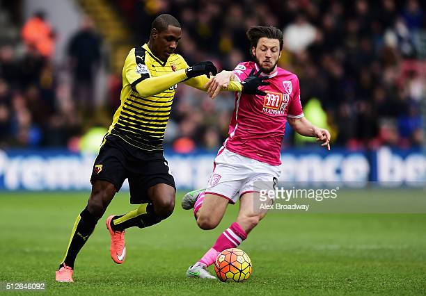 Odion Ighalo of Watford and Harry Arter of Bournemouth compete for the ball during the Barclays Premier League match between Watford and AFC...