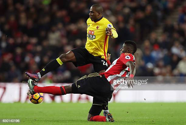 Odion Ighalo of Watford and Papy Djilobodji of Sunderland battle for possession during the Premier League match between Sunderland and Watford at...
