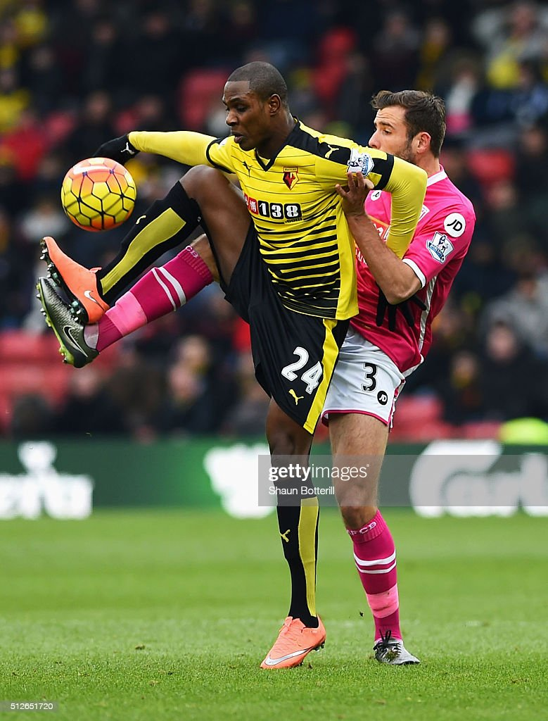 Odion Ighalo of Watford and Steve Cook of Bournemouth compete for the ball during the Barclays Premier League match between Watford and A.F.C. Bournemouth at Vicarage Road on February 27, 2016 in Watford, England.