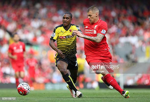 Odion Ighalo of Watford battles for the ball with Cameron Brannagan of Liverpool during the Barclays Premier League match between Liverpool and...