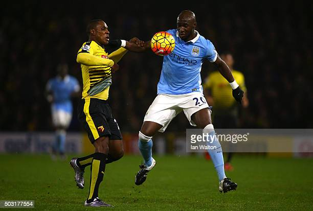 Odion Ighalo of Watford battles for the ball with Eliaquim Mangala of Manchester City during the Barclays Premier League match between Watford and...