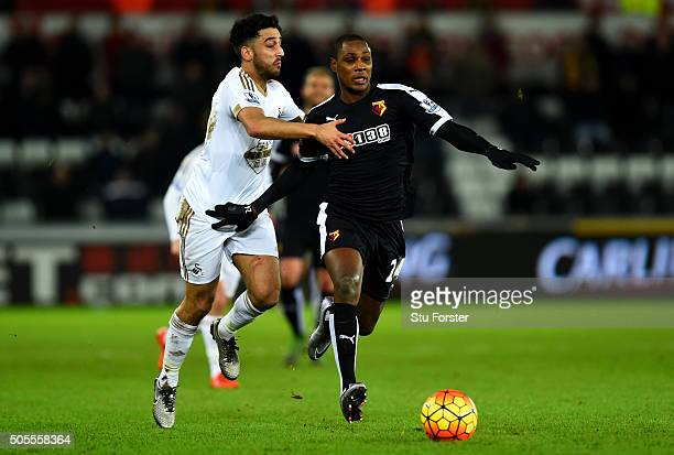 Odion Ighalo of Watford battles for the ball with Neil Taylor of Swansea City during the Barclays Premier League match between Swansea City and...