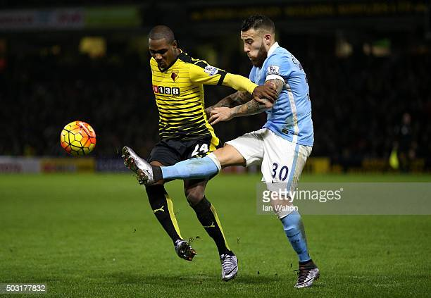 Odion Ighalo of Watford battles for the ball with Nicolas Otamendi of Manchester City during the Barclays Premier League match between Watford and...