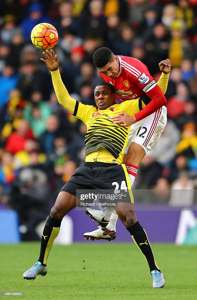 Odion Ighalo of Watford battles with Chris Smalling of Manchester United during the Barclays Premier League match between Watford and Manchester United at Vicarage Road on November 21, 2015 in Watford, England.