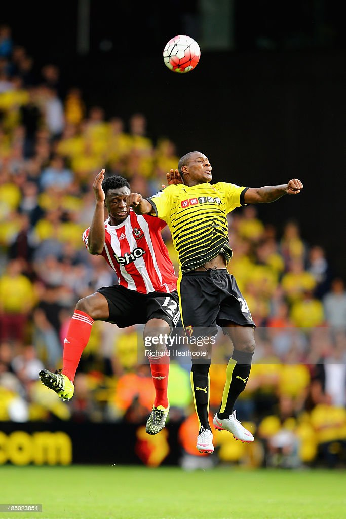 Odion Ighalo of Watford battles with Victor Wanyama of Southampton during the Barclays Premier League match between Watford and Southampton at Vicarage Road on August 23, 2015 in Watford, United Kingdom.