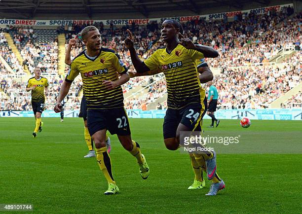 Odion Ighalo of Watford celebrates scoring his team's first goal with his team mate Almen Abdi during the Barclays Premier League match between...