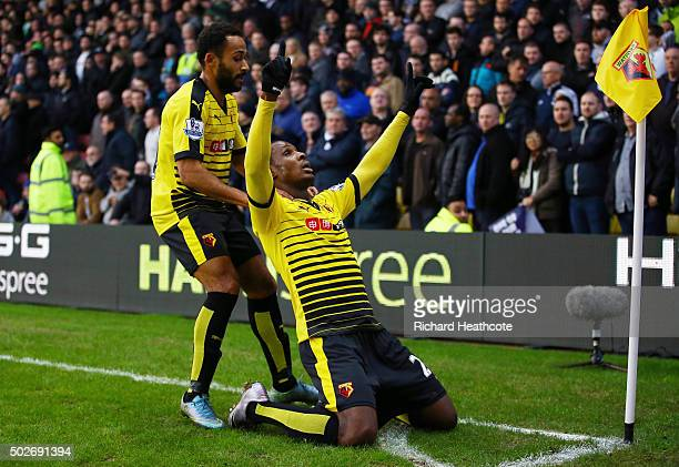 Odion Ighalo of Watford celebrates scoring his team's first goal with his team mate Ikechi Anya during the Barclays Premier League match between...