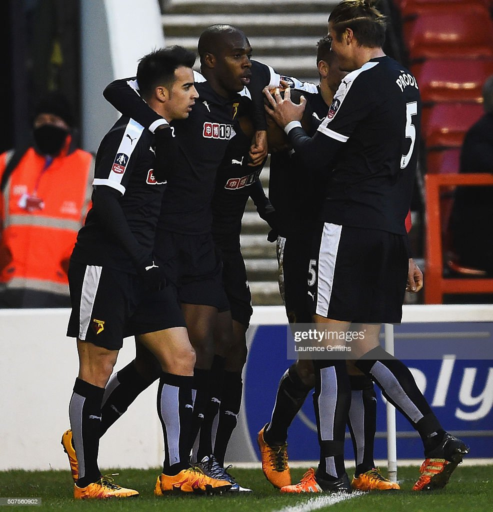 Odion Ighalo (C, obscured) of Watford celebrates scoring his team's first goal with his team mates during The Emirates FA Cup fourth round between Nottingham Forest and Watford at City Ground on January 30, 2016 in Nottingham, England.