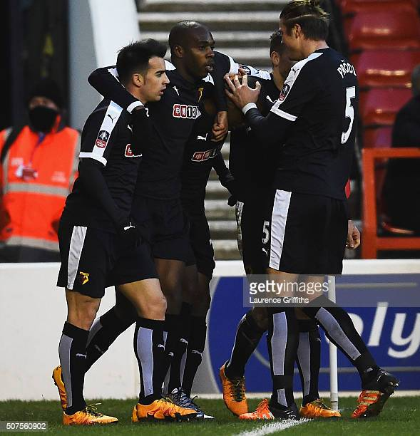 Odion Ighalo of Watford celebrates scoring his team's first goal with his team mates during The Emirates FA Cup fourth round between Nottingham...