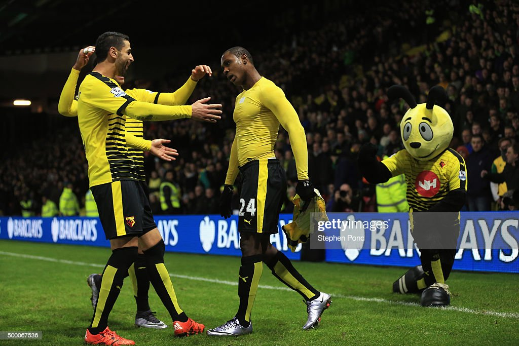 Odion Ighalo of Watford celebrates scoring his team's second goal with his team mates during the Barclays Premier League match between Watford and Norwich City at Vicarage Road on December 5, 2015 in Watford, England.