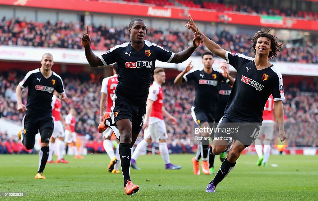 Odion Ighalo of Watford (24) celebrates with team mate Nathan Ake (16) as he scores their first goal during the Emirates FA Cup sixth round match between Arsenal and Watford at Emirates Stadium on March 13, 2016 in London, England.