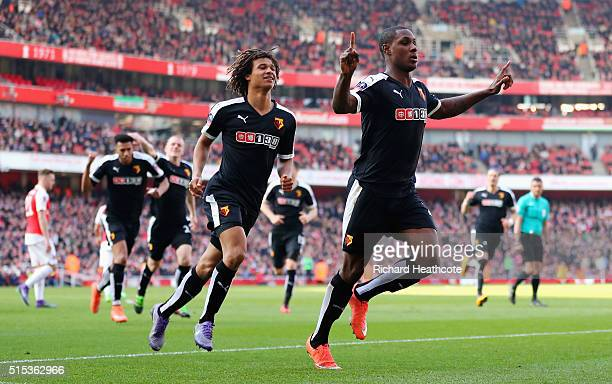 Odion Ighalo of Watford celebrates with team mate Nathan Ake as he scores their first goal during the Emirates FA Cup sixth round match between...