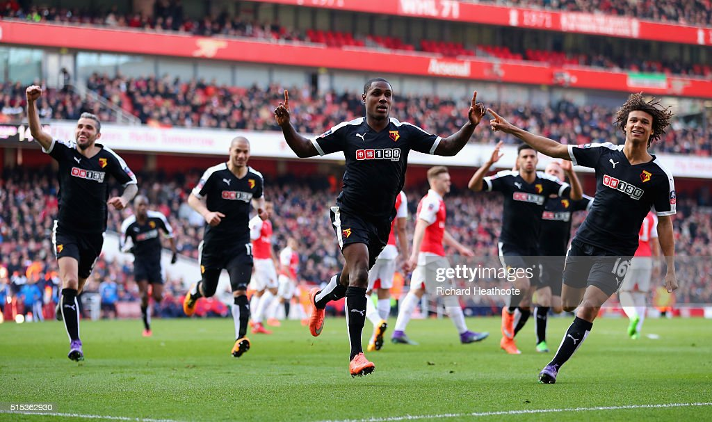 Odion Ighalo of Watford (24) celebrates with team mates as he scores their first goal during the Emirates FA Cup sixth round match between Arsenal and Watford at Emirates Stadium on March 13, 2016 in London, England.