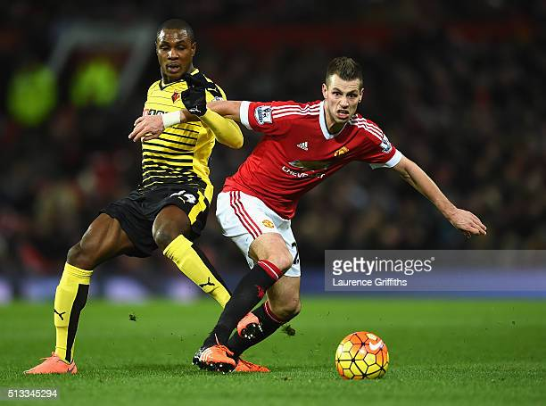Odion Ighalo of Watford challenges Morgan Schneiderlin of Manchester United during the Barclays Premier League match between Manchester United and...