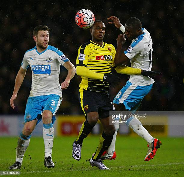 Odion Ighalo of Watford competes for the ball against Paul Dummett and Chancel Mbemba of Newcastle United during the Emirates FA Cup Third Round...