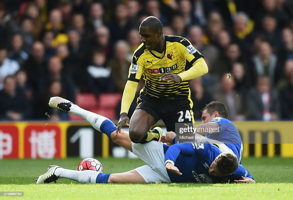 Odion Ighalo of Watford competes for the ball against Seamus Coleman and Phil Jagielka of Everton during the Barclays Premier League match between Watford and Everton at Vicarage Road on April 9, 2016 in Watford, England.