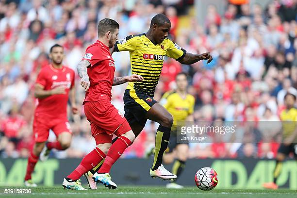 Odion Ighalo of Watford holds off Alberto Moreno of Liverpool during the Barclays Premier League match between Liverpool and Watford at Anfield on...