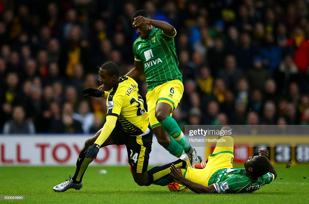 Odion Ighalo (L) of Watford is brought down by Alexander Tettey (R) of Norwich City resulting in a penalty kick during the Barclays Premier League match between Watford and Norwich City at Vicarage Road on December 5, 2015 in Watford, England.