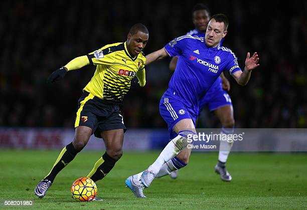 Odion Ighalo of Watford is challenged by John Terry of Chelsea during the Barclays Premier League match between Watford and Chelsea at Vicarage Road...