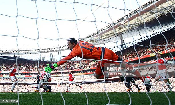 Odion Ighalo of Watford obscured scores their firstgoal past goalkeeper David Ospina of Arsenal during the Emirates FA Cup sixth round match between...