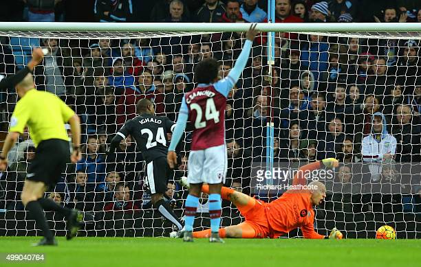 Odion Ighalo of Watford scores his team's first goal past Brad Guzan of Aston Villa during the Barclays Premier League match between Aston Villa and...