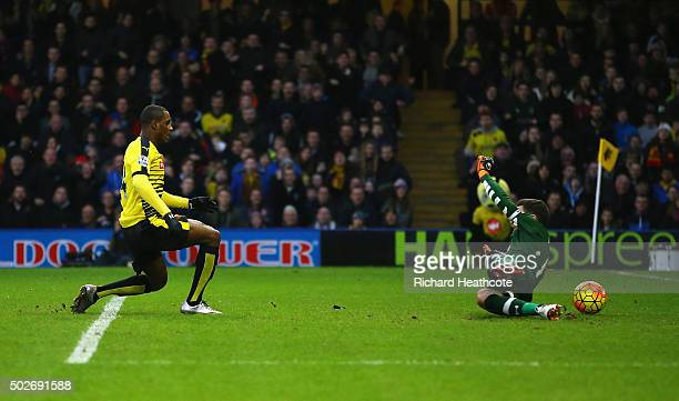 Odion Ighalo of Watford scores his team's first goal past Hugo Lloris of Tottenham Hotspur during the Barclays Premier League match between Watford...