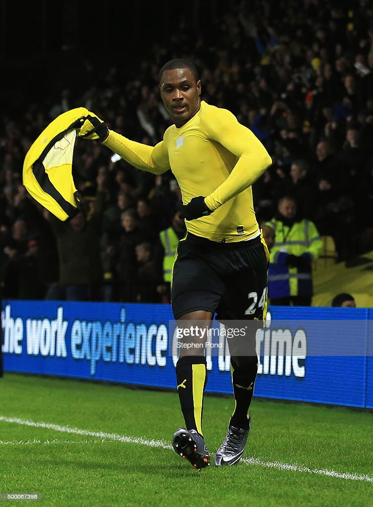 Odion Ighalo of Watford takes off his shirt to celebrate scoring his team's second goal during the Barclays Premier League match between Watford and Norwich City at Vicarage Road on December 5, 2015 in Watford, England.