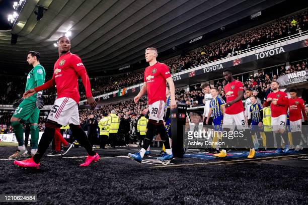 Odion Ighalo Scott McTominay and Eric Bailly of Manchester United walks out ahead of the FA Cup Fifth Round match between Derby County and Manchester...