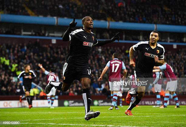 Odion Ighaloof Watford celebrates scoring his team's first goal past Brad Guzan of Aston Villa during the Barclays Premier League match between Aston...