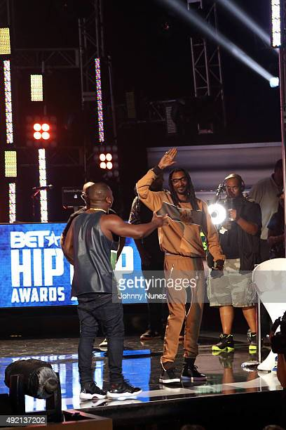 Odis Flores and Snoop Dogg appear onstage during the 2015 BET Hip Hop Awards at Boisfeuillet Jones Atlanta Civic Center on October 9 in Atlanta...