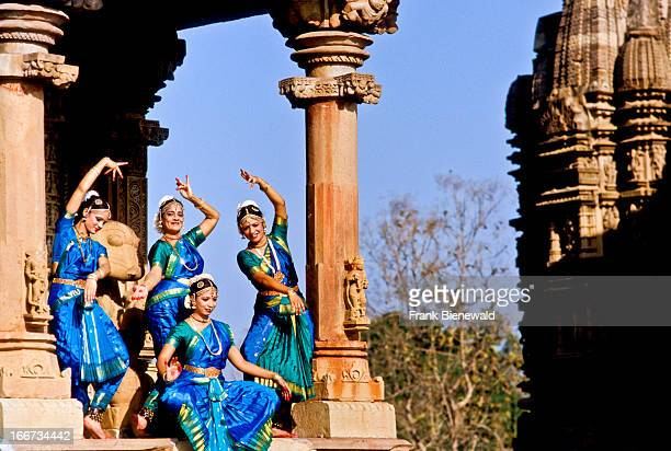 Odissidancers posing in front of the Khajuraho temples