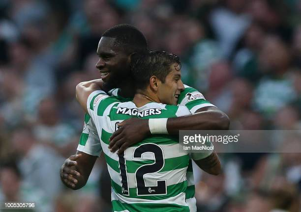 Odsonne Edouard of Celtic celebrates with team mate Cristian Gamboa after scoring his team's third goal during the first leg UEFA Champions League...