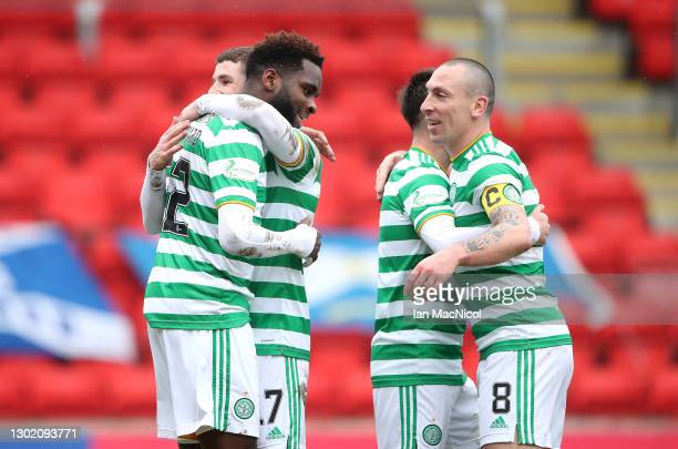 Odsonne Edouard of Celtic celebrates with teammates after scoring their team's second goal during the Ladbrokes Scottish Premiership match between...