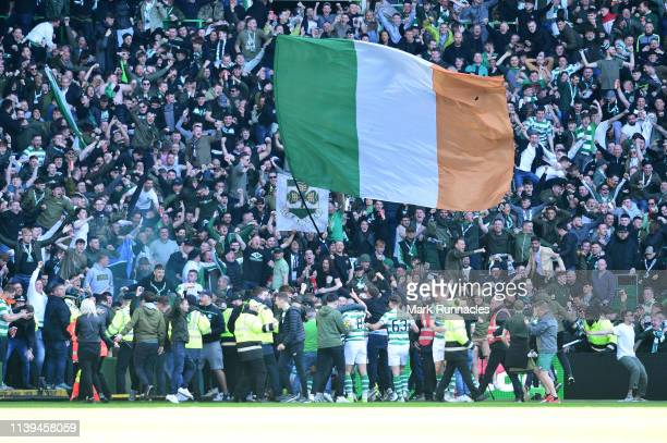 Odsonne Edouard of Celtic celebrates with the fans after he scores his sides first goal but is given a yellow card for causing a pitch invasion...
