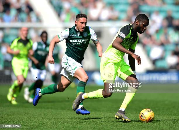 Odsonne Edouard of Celtic is challenged by Mark Milligan of Hibernian during the Ladbrokes Premiership match between Hibernian and Celtic at Easter...