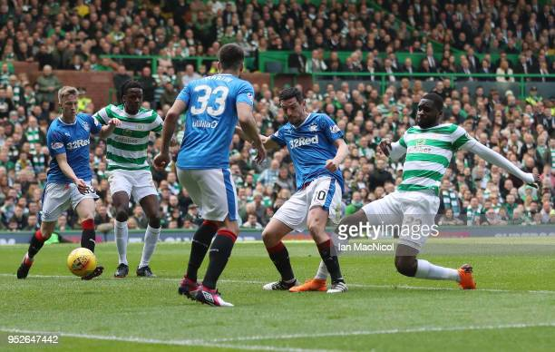 Odsonne Edouard of Celtic scores his sides first goal while under pressure from Graham Dorrans of Rangers during the Scottish Premier League match...
